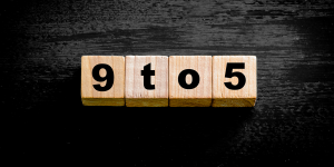 Header image - wooden blocks spelling out 9 to 5