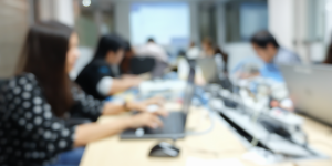 Abstract blurred out header image of people working at omputers